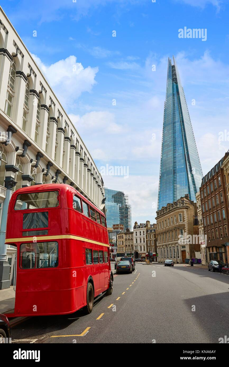 The Shard and old London red Bus in England. - Stock Image