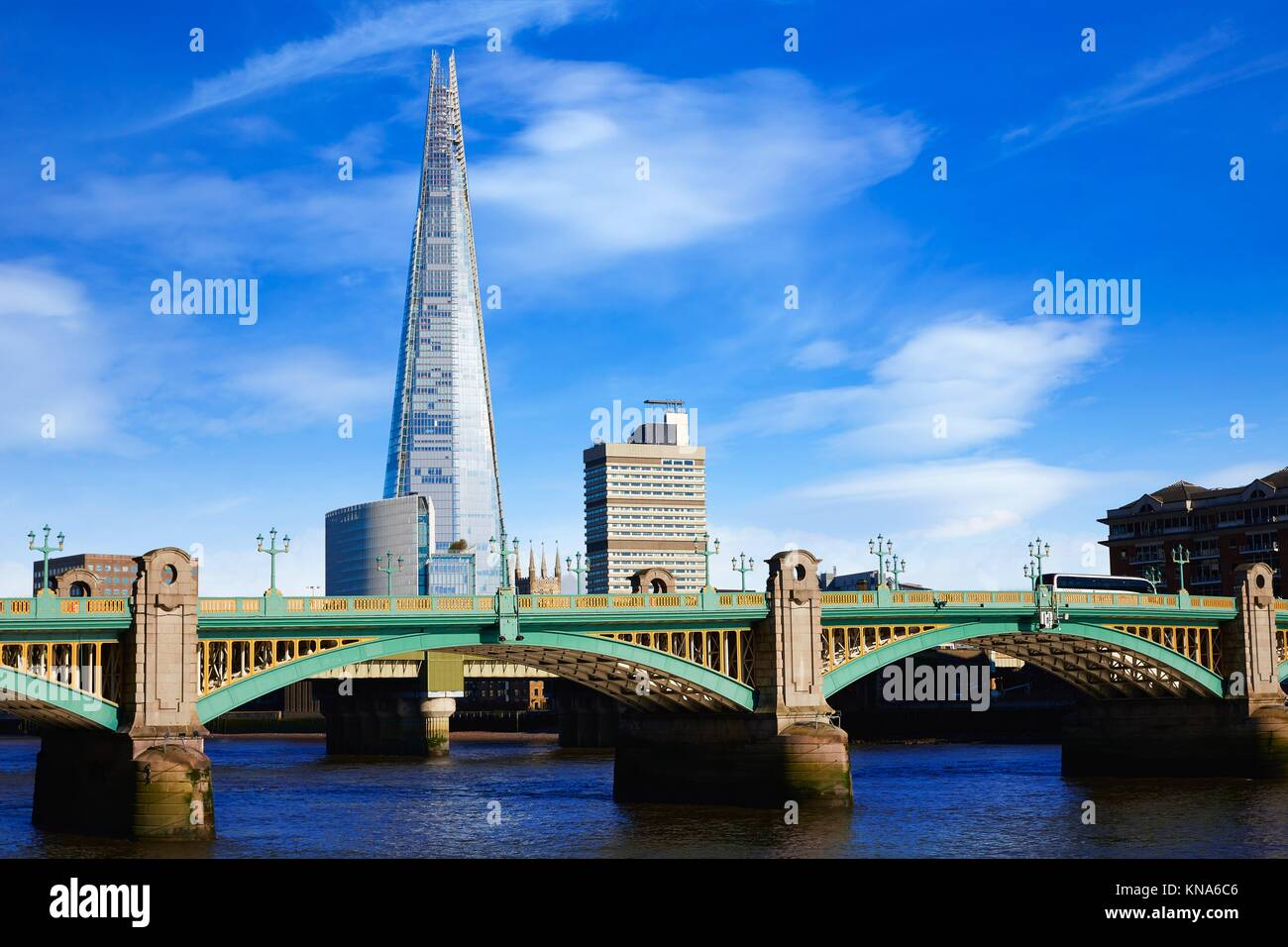 London Southwark bridge and the Shard on Thames river in UK. - Stock Image