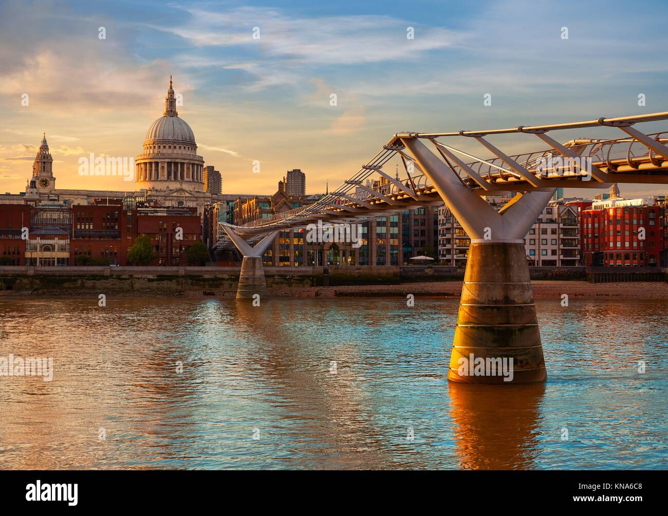 London St Paul Pauls cathedral sunset from Millennium bridge on Thames UK. - Stock Image