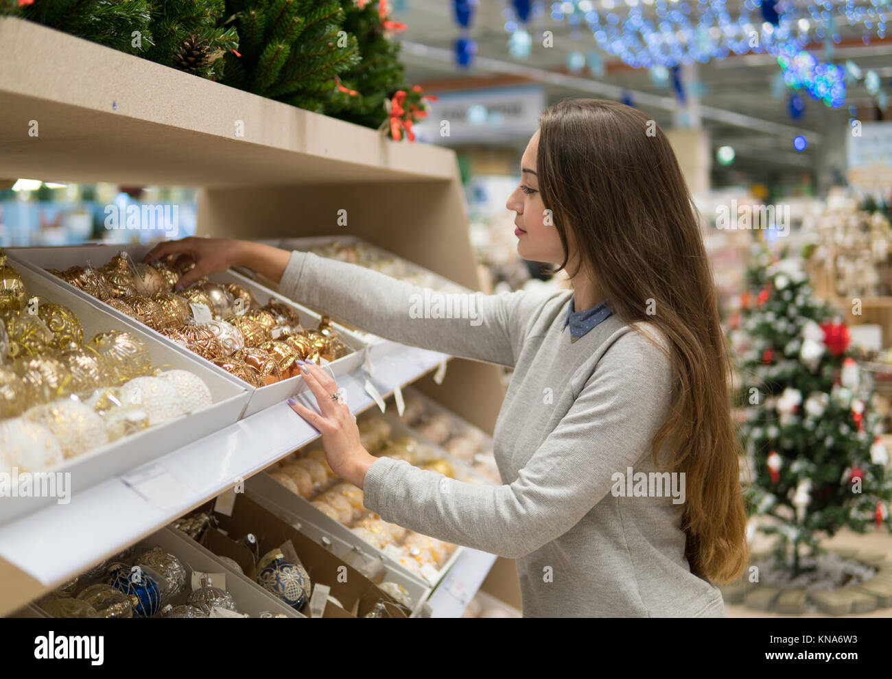 customer girl choosing gifts for Christmas and New Year Stock Photo