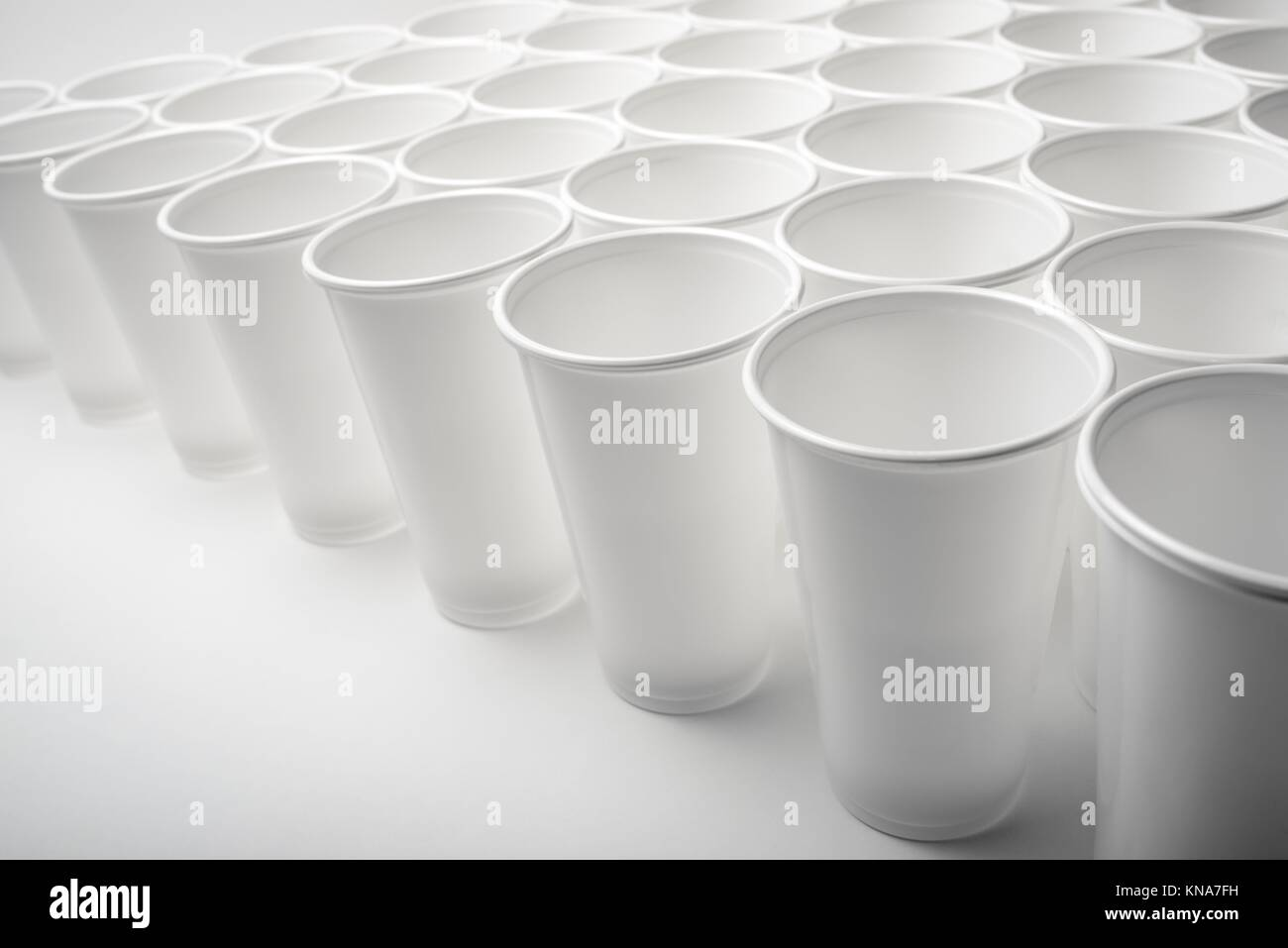 Large group of disposable plastic cups. - Stock Image