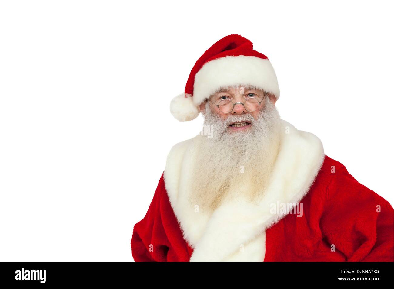 Santa Claus with real white beard looks angry (isolated). - Stock Image