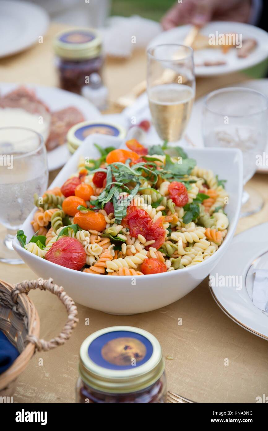 Family Style Pasta At An Outdoor Wedding Reception In Oregon Stock Photo Alamy