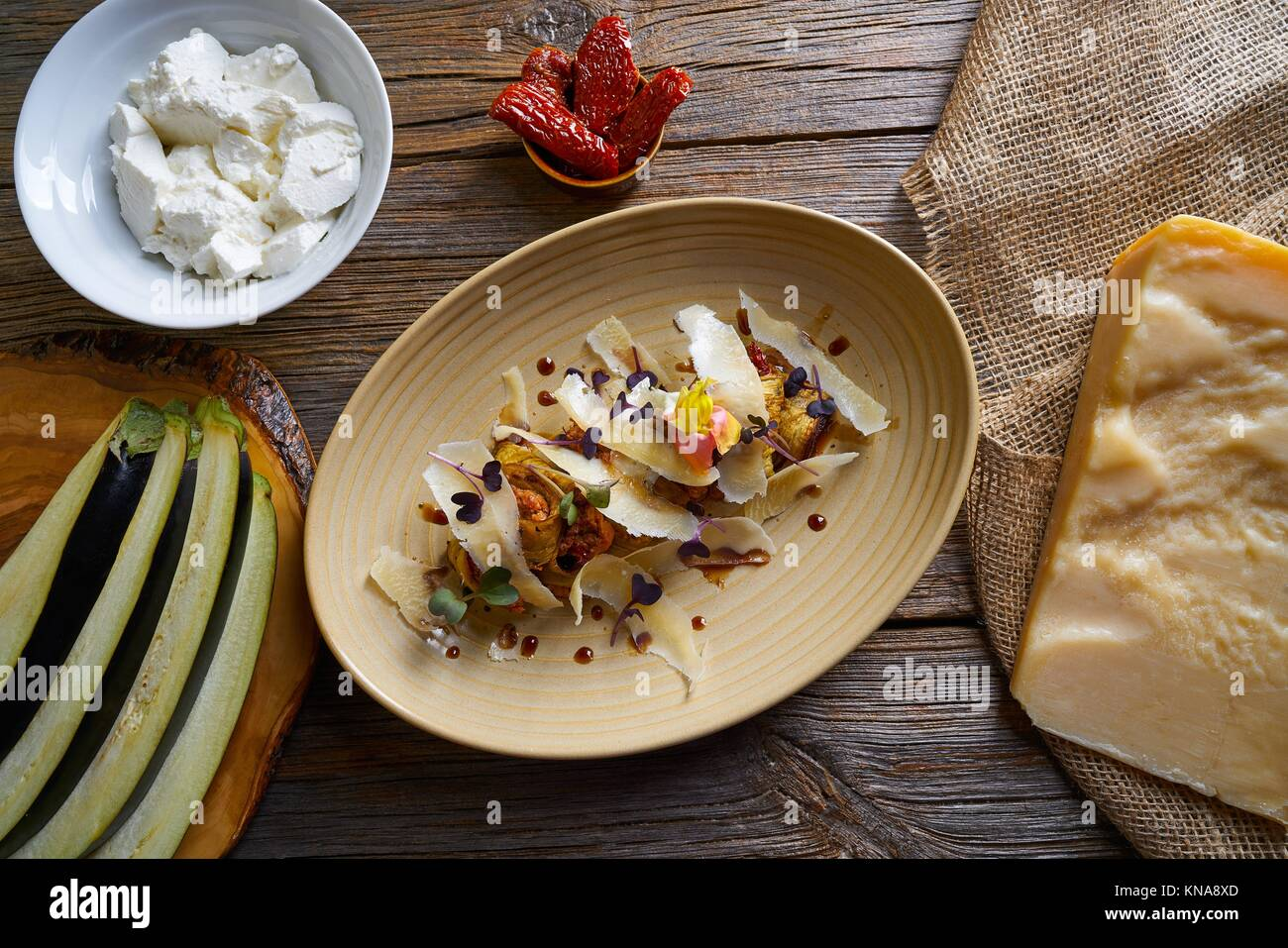 Aubergine and cheese recipe italian food on wood table. - Stock Image