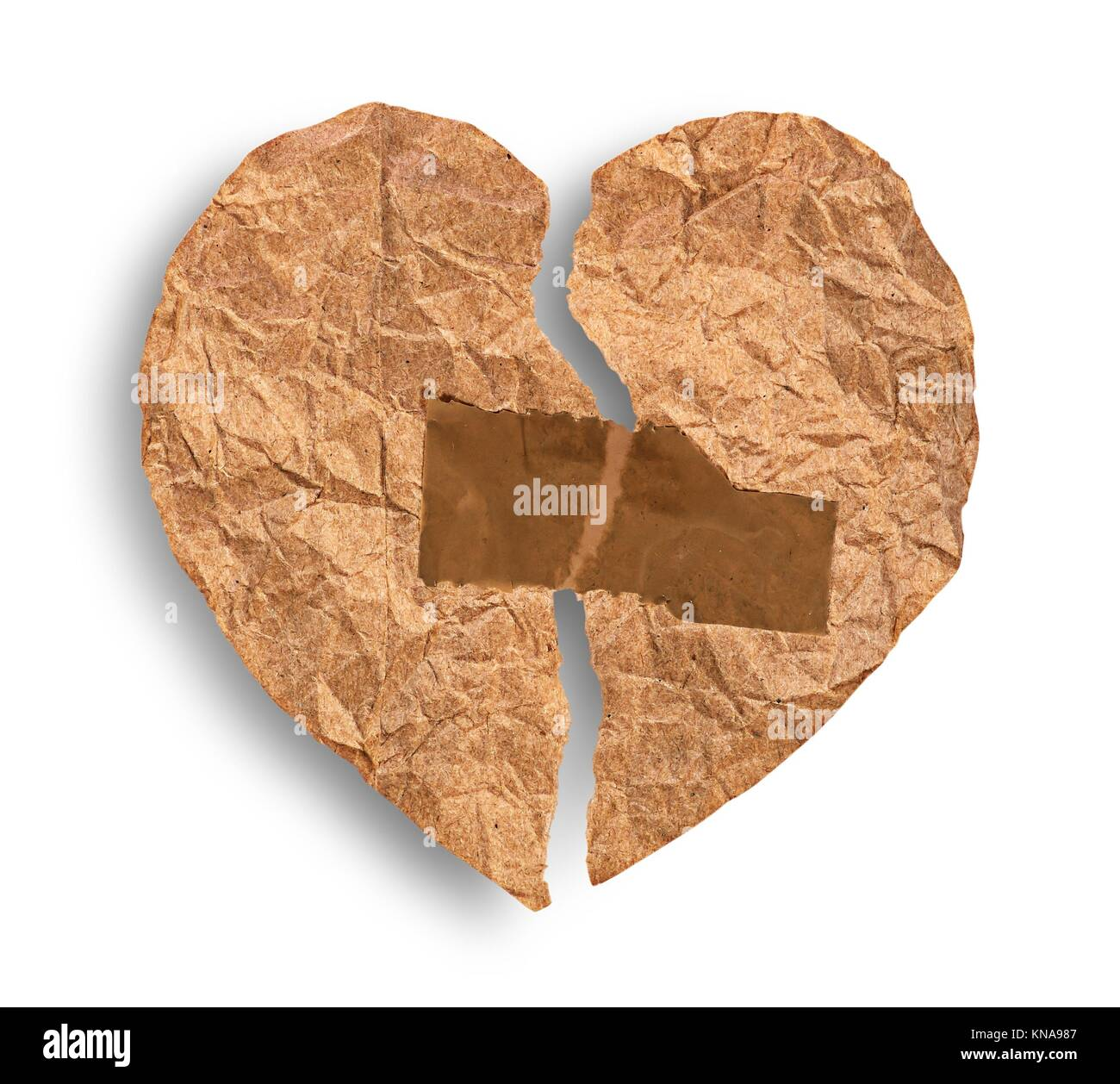 Broken crumpled paper heart coupled with tape isolated on white background. - Stock Image