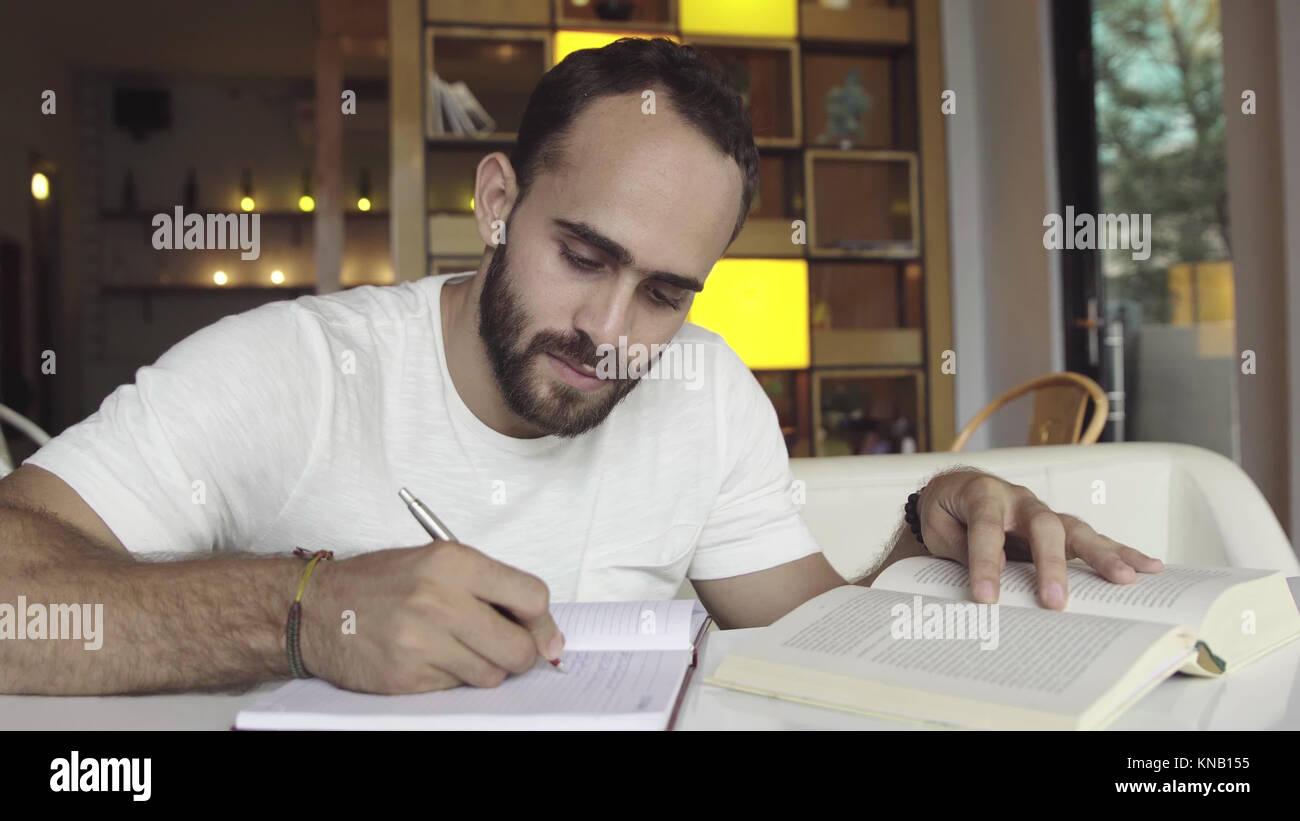 Man studying, preparing for exam - Stock Image