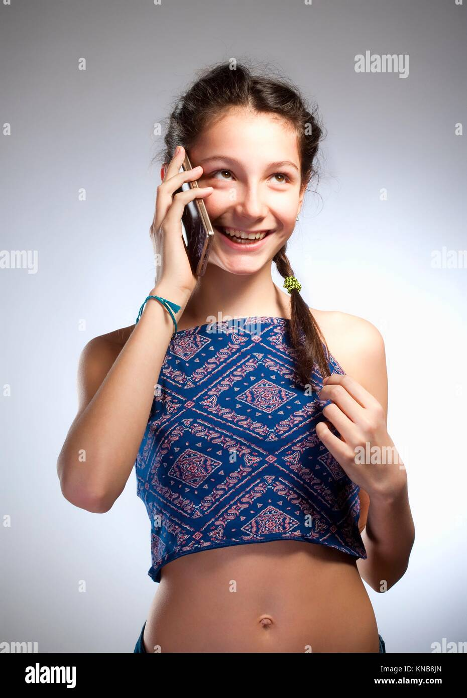Preadolescent Girl Talking on the Phone. - Stock Image