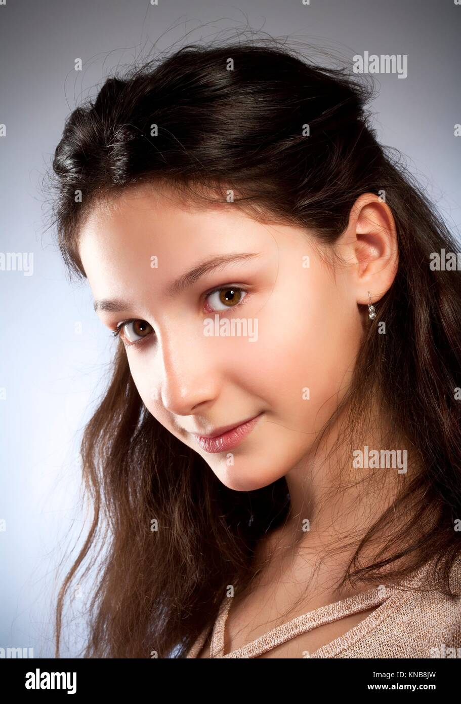 Portrait of a Preadolescent Girl with Brown Hair. - Stock Image
