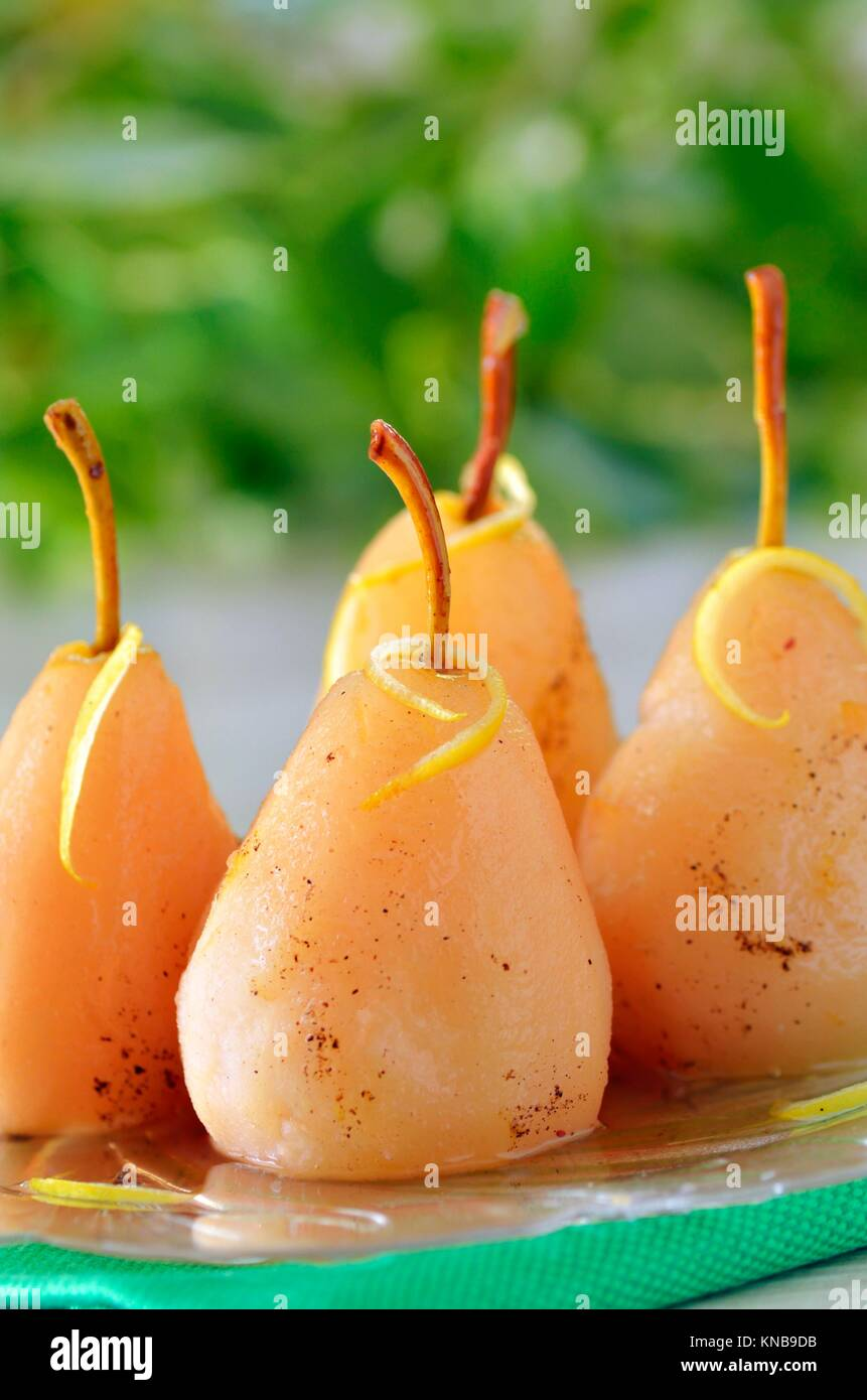 four pears poached in syrup. Stock Photo
