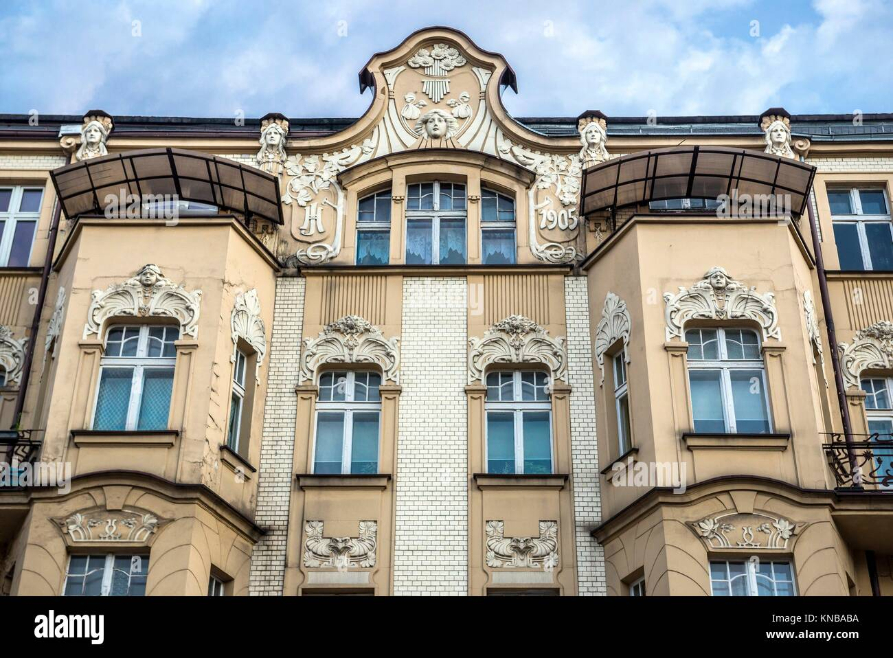 Tenement house on Adam Mickiewicz Street in downtown of Katowice city, the center of the Silesian Metropolis in Stock Photo