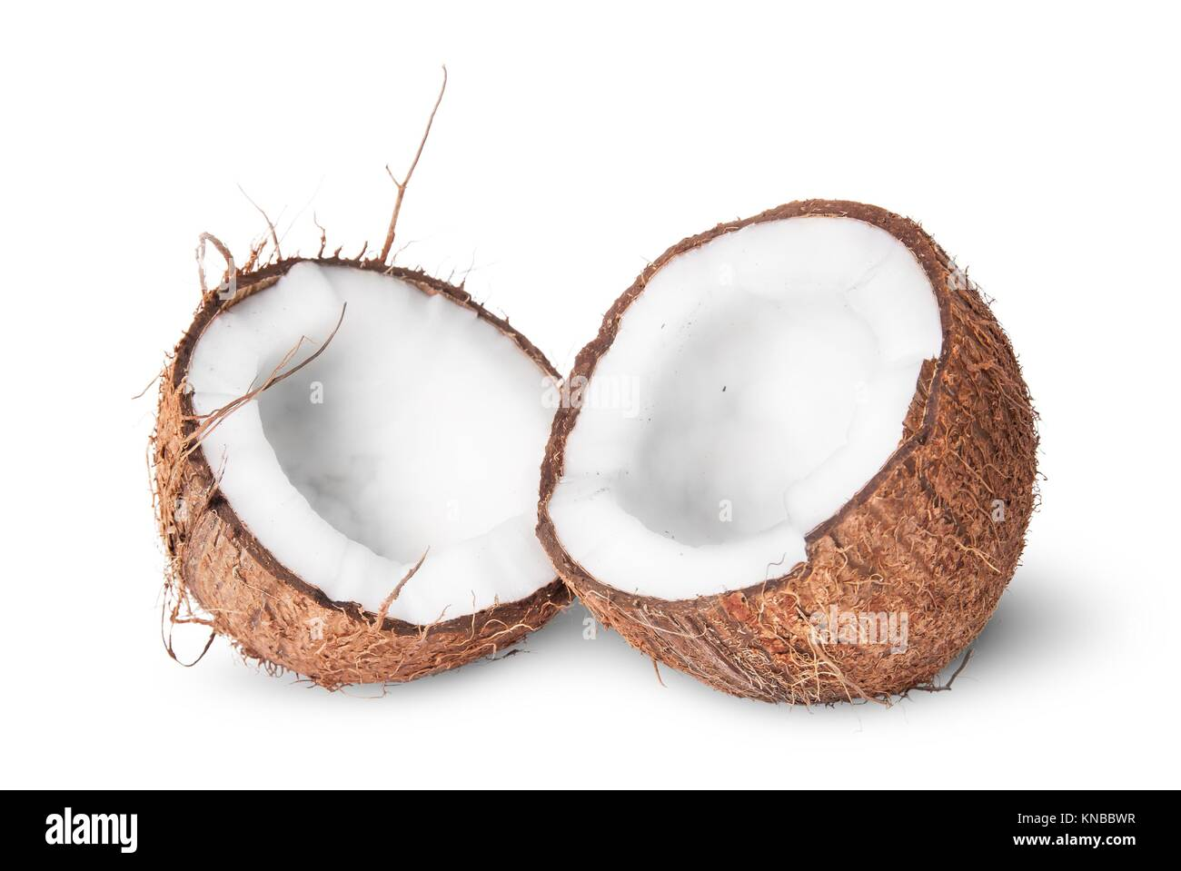 Two halves of coconut isolated on white background. - Stock Image