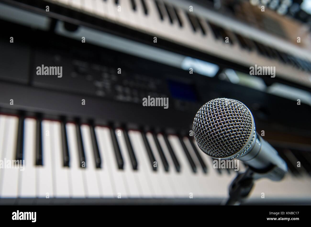 Studio room with synthesizer and microphone equipment, France. - Stock Image