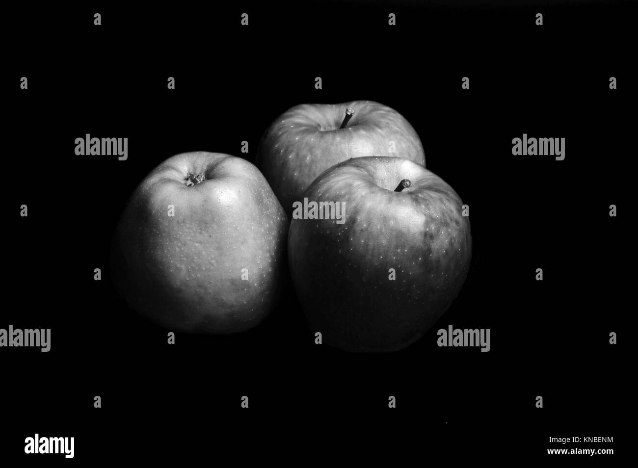 trhee apples with black and white, fruit. - Stock Image