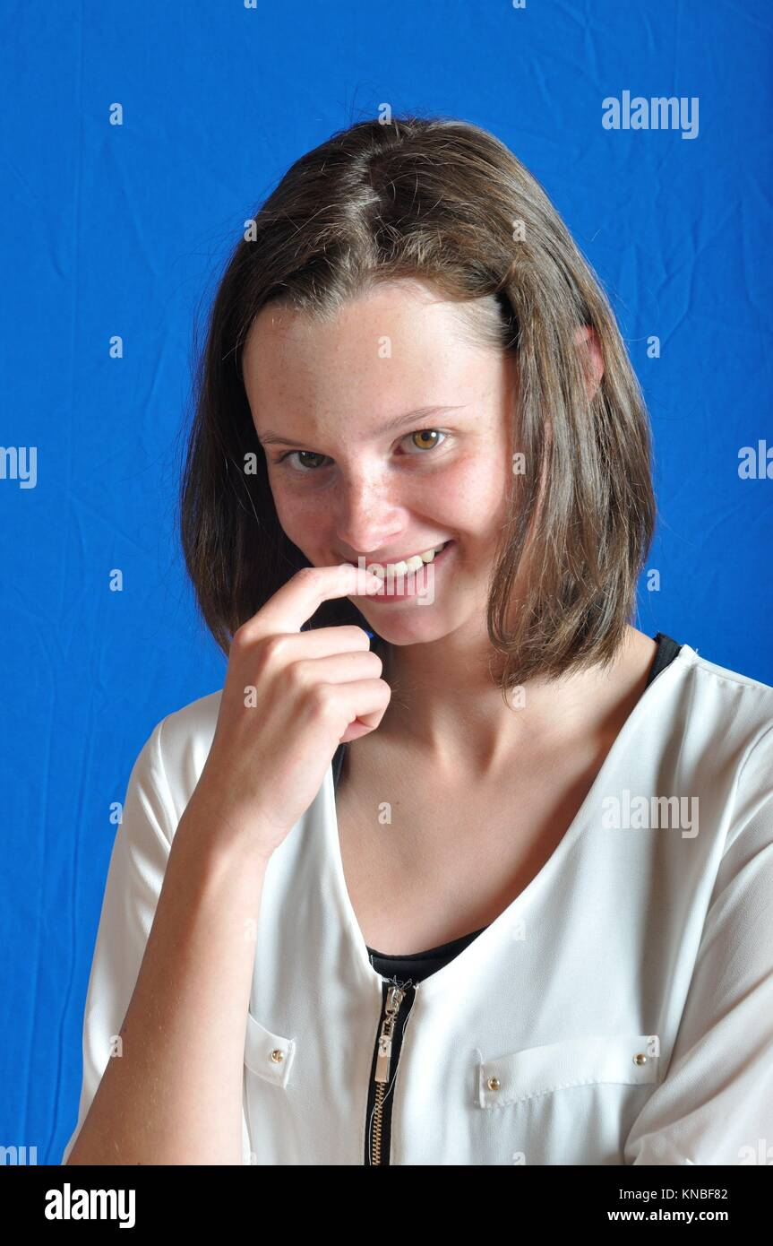 Teen playing the shy. - Stock Image
