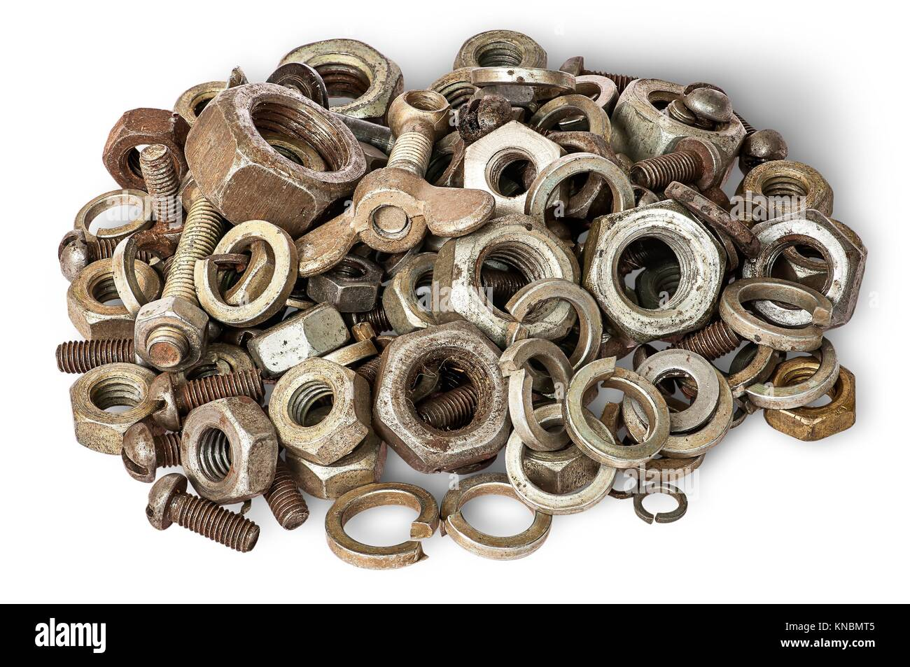 Pile of old fasteners top view isolated on white background. - Stock Image