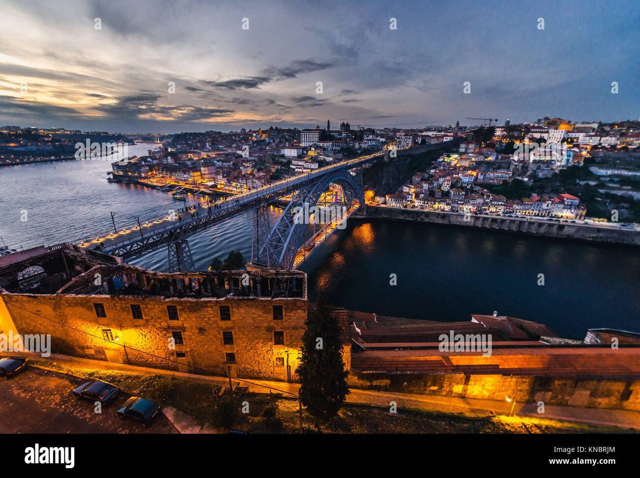 Sunset over Porto city, second largest city in Portugal. Aerial view with Dom Luis I Bridge from Serra do Pilar - Stock Image