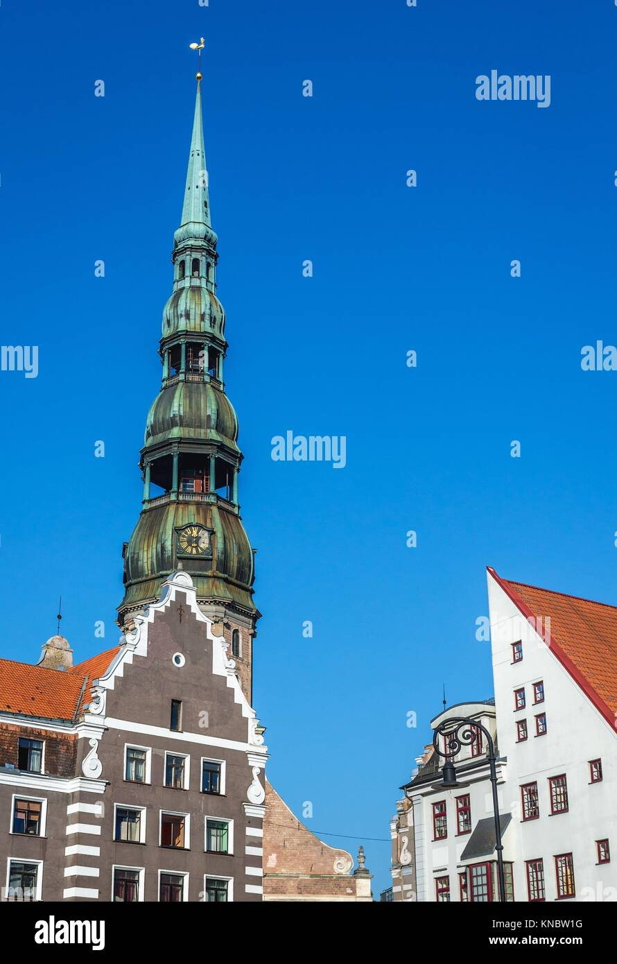 Residential buildings on Albert Square on the Old Town of Riga, capital city of Republic of Latvia. Bell tower of - Stock Image
