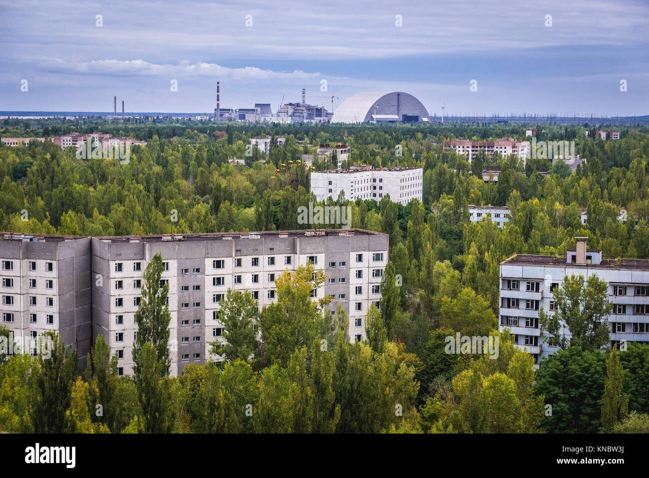 Aerial view of Pripyat ghost city, Ukraine. View with New Safe Confinement of Chernobyl Nuclear Power Plant. - Stock Image