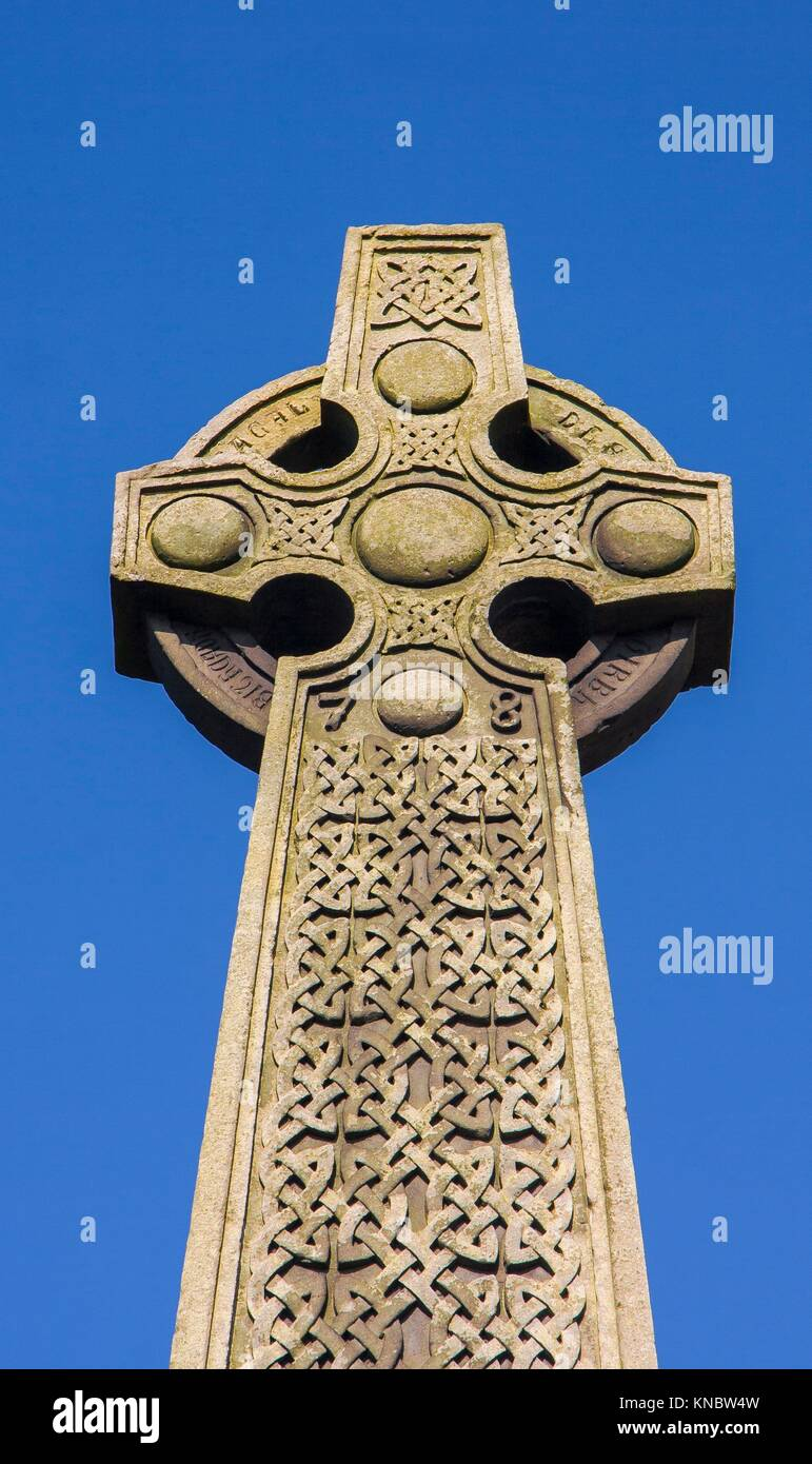 Celtic Cross Against Blue Sky. Outside Of Edinburgh Castle, Scotland.