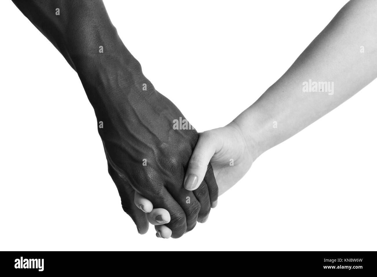 One caucasian and one african hand on white background. Stock Photo