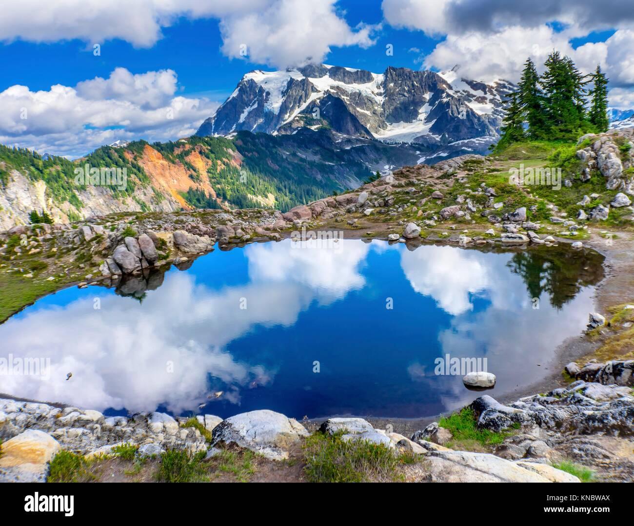 Mount Shuksan Pool Reflection Summer Artist Point Mount Baker Highway. Pacific Northwest, Washington State, Snow - Stock Image