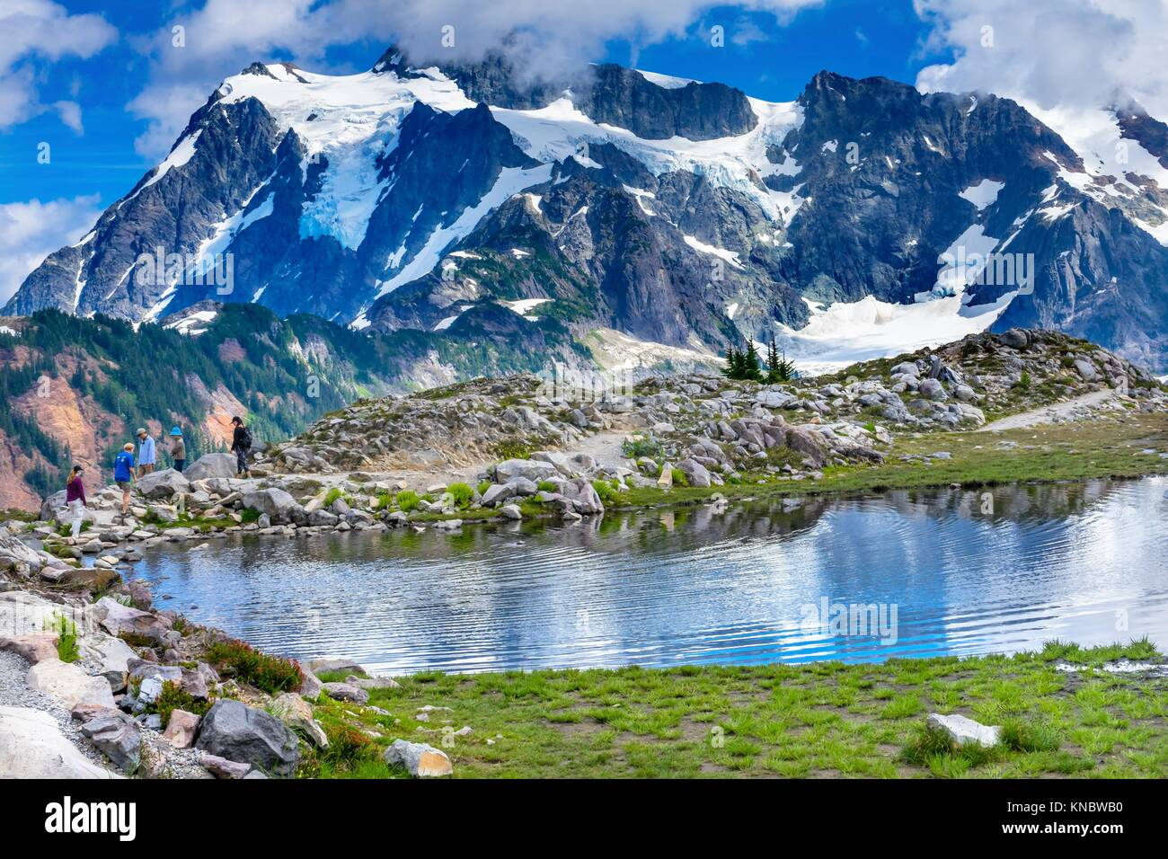 Hikers Mount Shuksan Pool Reflection Summer Artist Point Mount Baker Highway. Pacific Northwest, Washington State, Stock Photo