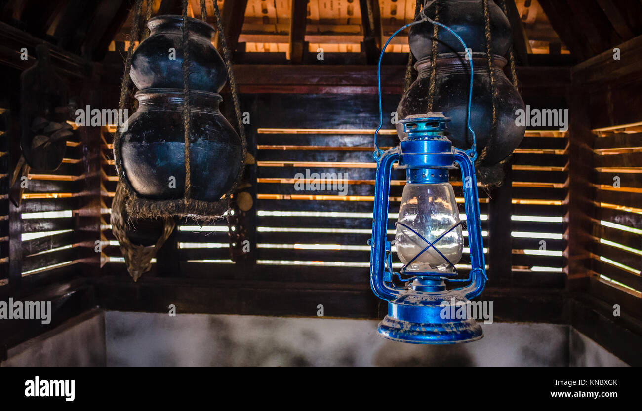 Antique lantern used in medieval period against some traditional household potteries - Stock Image