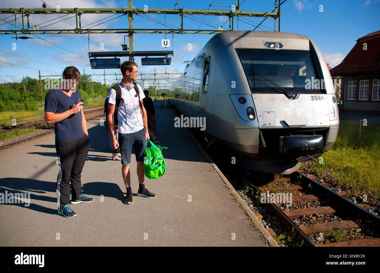 Man leaving on train, countryside of northern Sweden. - Stock Image