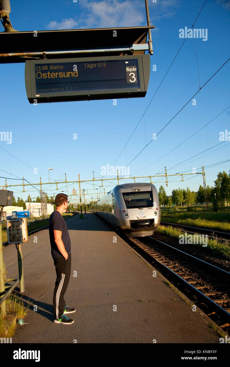 Man waiting for the train in Bräcke, countryside of northern Sweden. - Stock Image