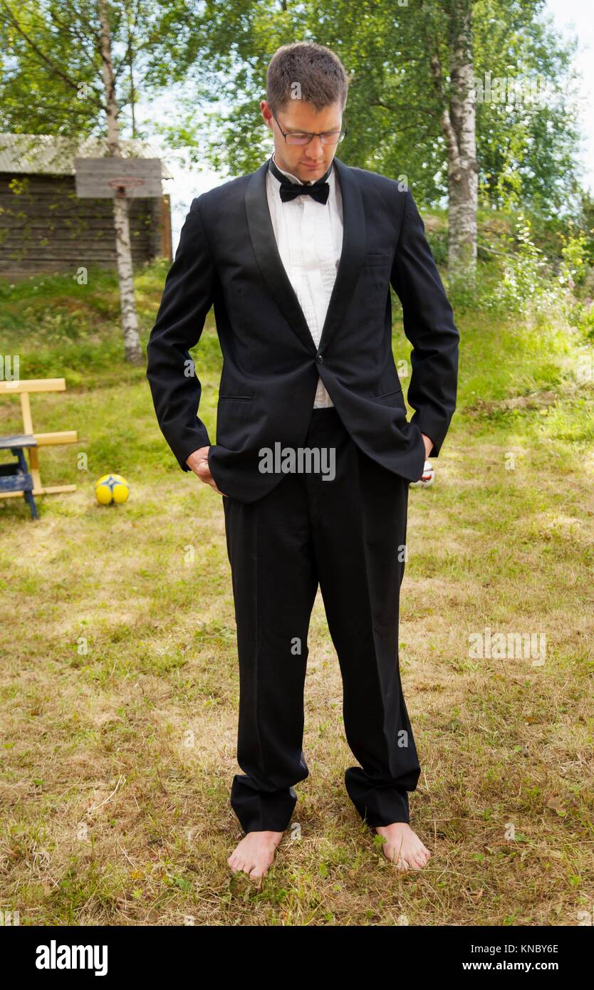 Man posing in a suit barefoot, Northern Sweden. - Stock Image