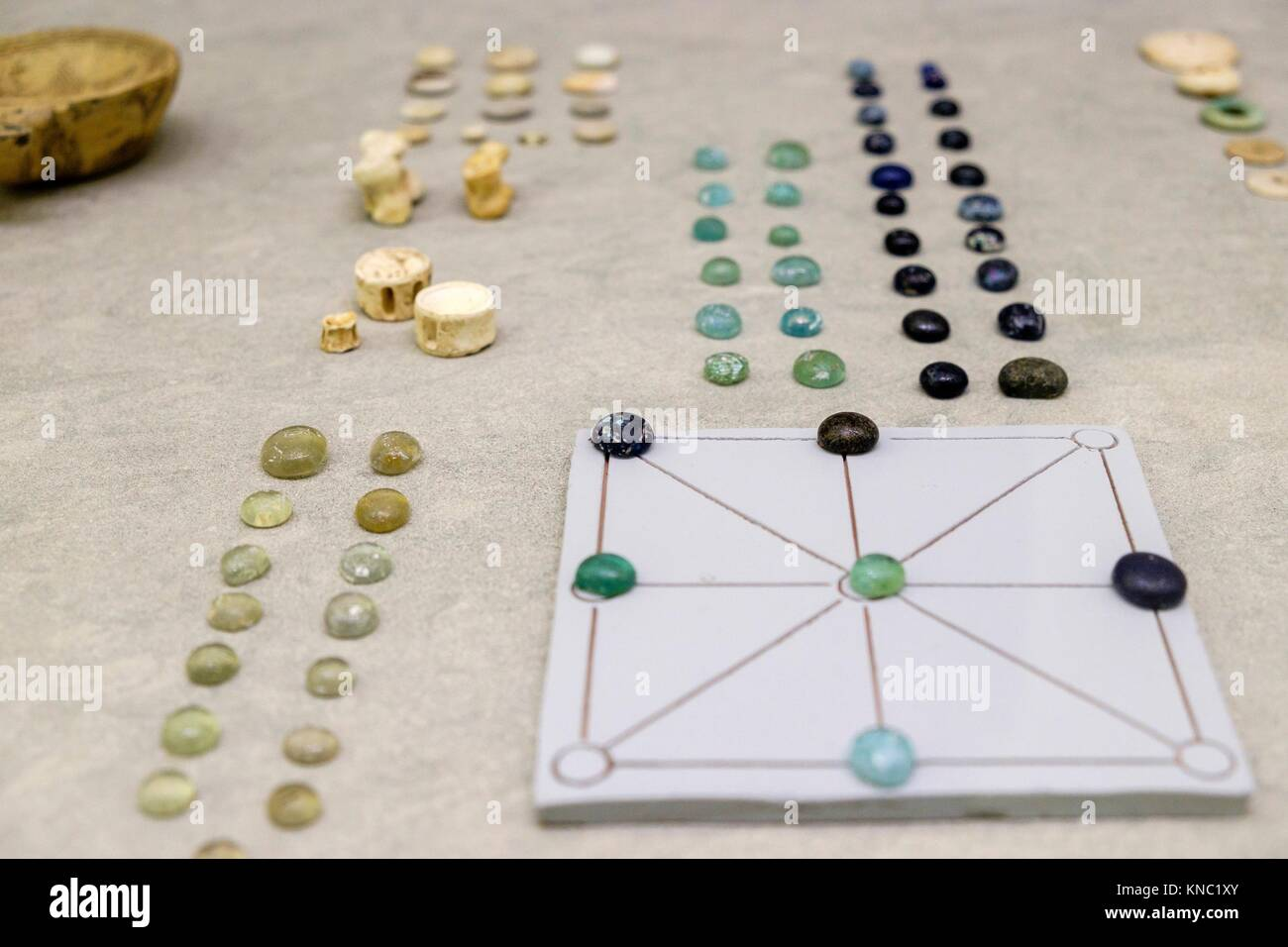 Game chips, dice and board, 1-300 AD., Ibiza and Formentera Archeological Museum, Patrimonio de la Humanidad «Ibiza, - Stock Image