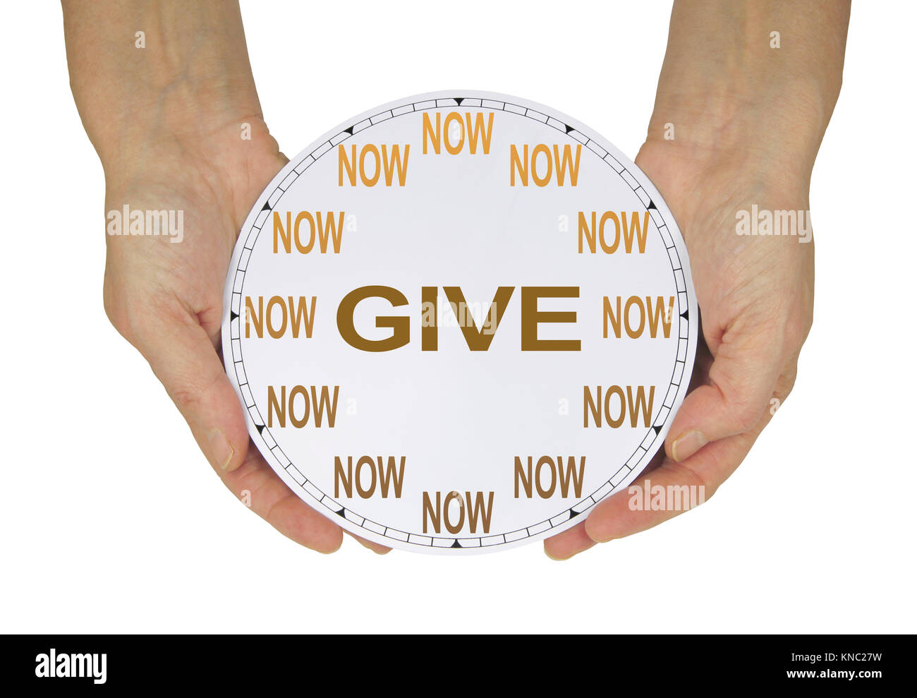 GIVE what you can NOW  - female hands holding a clock with no hands that has NOW in place of the numerals and GIVE - Stock Image