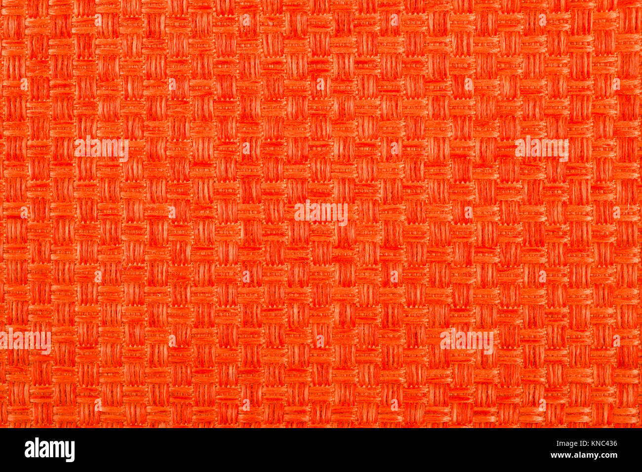 Background of orange colored cloth - Stock Image