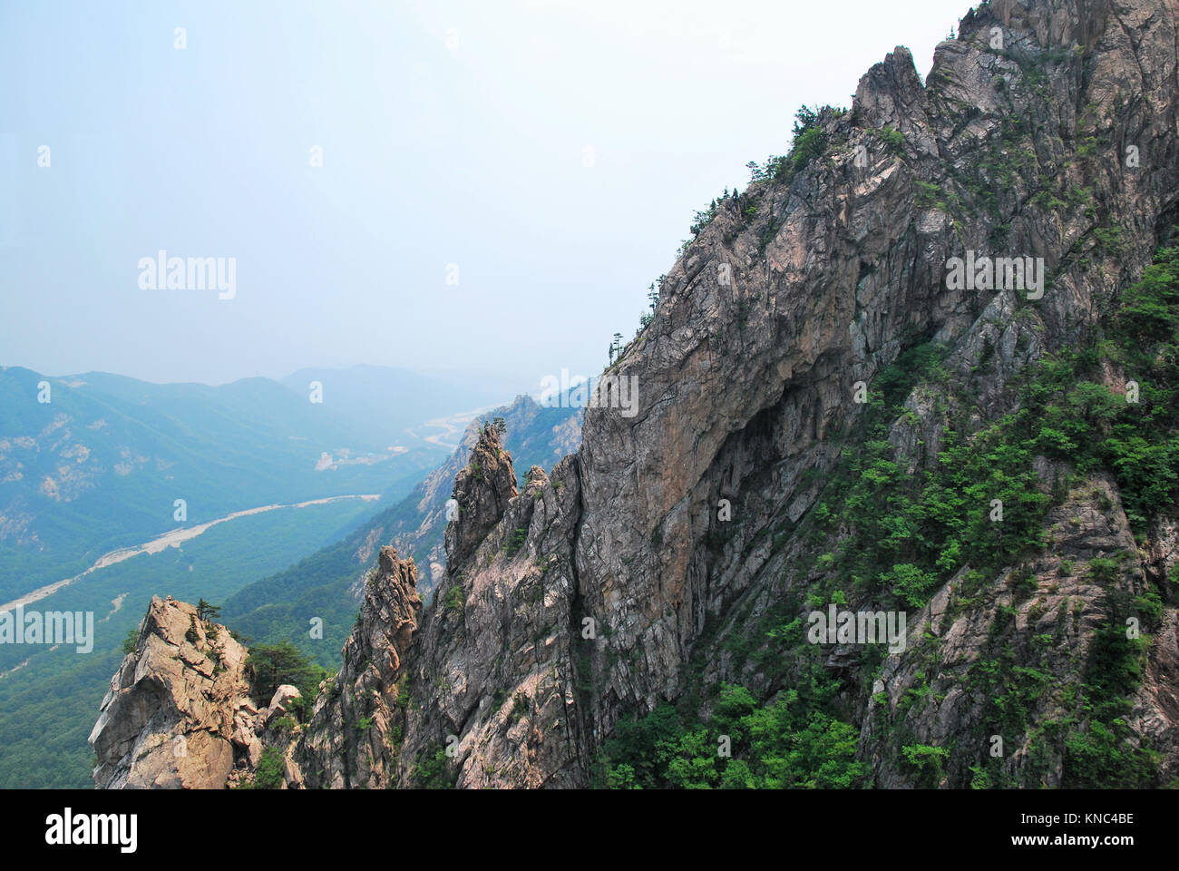 Treacherous mountain cliffs with pointed and jagged edges. Symbolizes abstract concepts such as danger, travel and - Stock Image