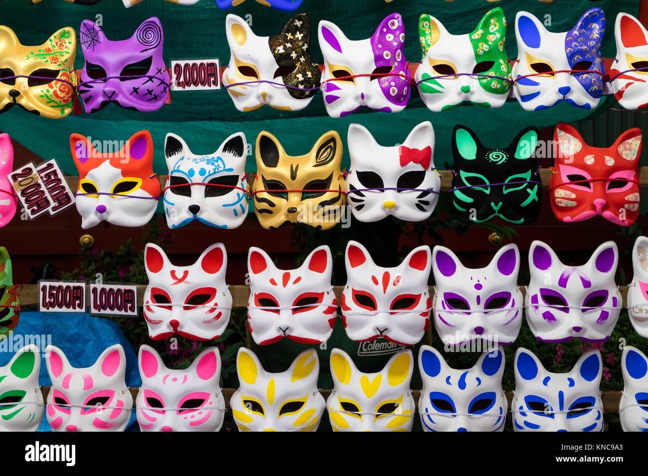 Tokyo, Japan - May 14, 2017: Cat masks for sale hanging on the wall at the Kanda Matsuri Festival. Stock Photo