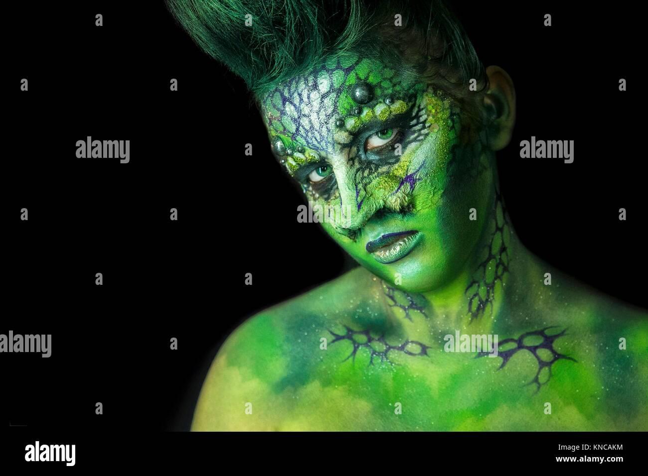 Fantastic Reptilian Girl. Creative Make up like Alien or Superhero Movie. Stock Photo