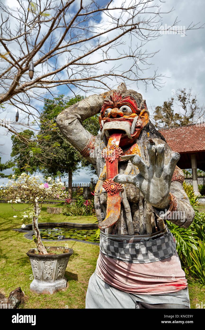Statue of Rangda, the demon queen, in the  Tirta Gangga water palace. Karangasem regency, Bali, Indonesia. - Stock Image