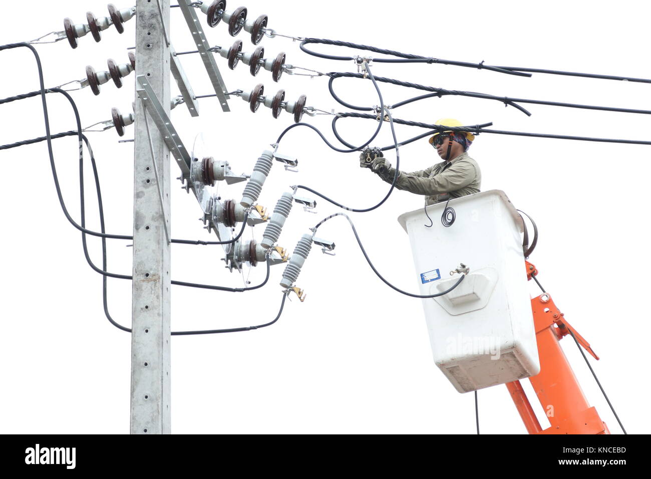 NONTHABURI, THAILAND - APRIL 29, 2017: Electrician are installing high powered electric cables to cope with the - Stock Image