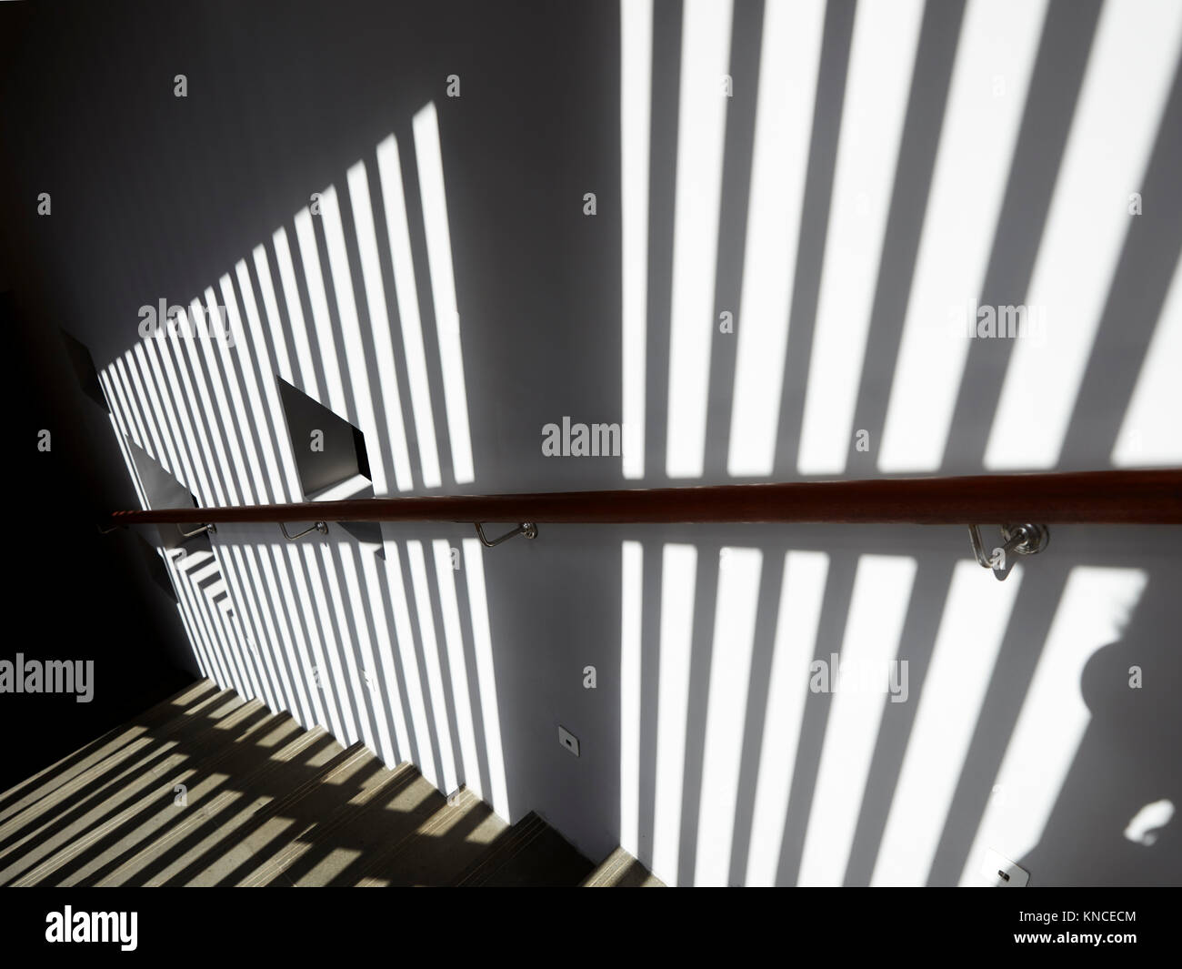 Sunlit stairwell in the main building of the Candi Beach Resort and Spa. Candidasa, Manggis subdistrict, Karangasem - Stock Image