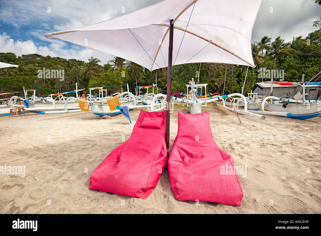Bean bag chairs and umbrella on White Sand Beach (Pantai Bias Putih). Manggis subdistrict, Karangasem Regency, Bali, - Stock Image