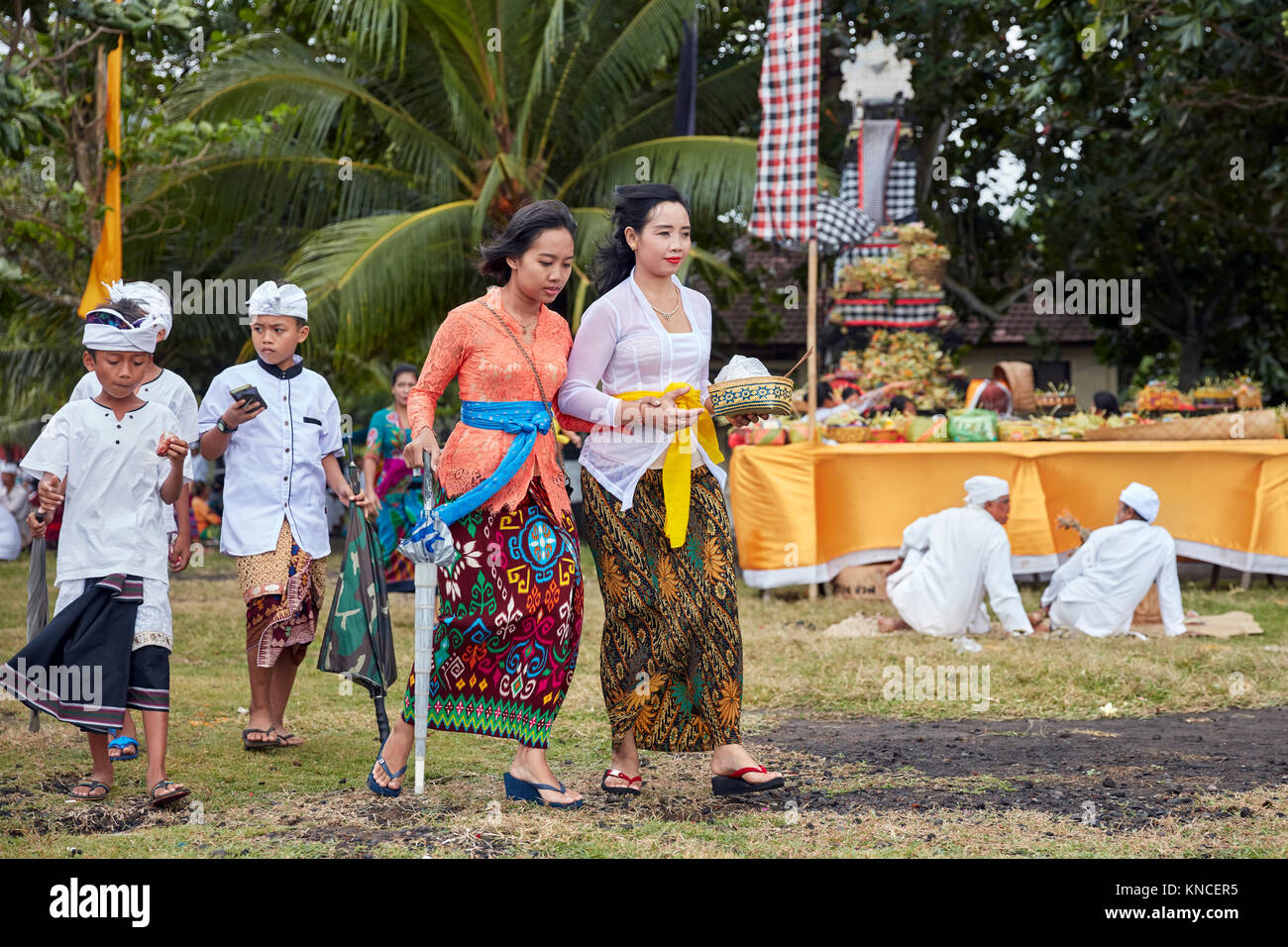 Women With Children Wearing Traditional Balinese Clothing Go To A