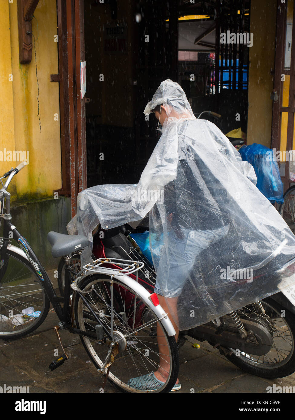 Motorcyclist In A Poncho - Stock Image