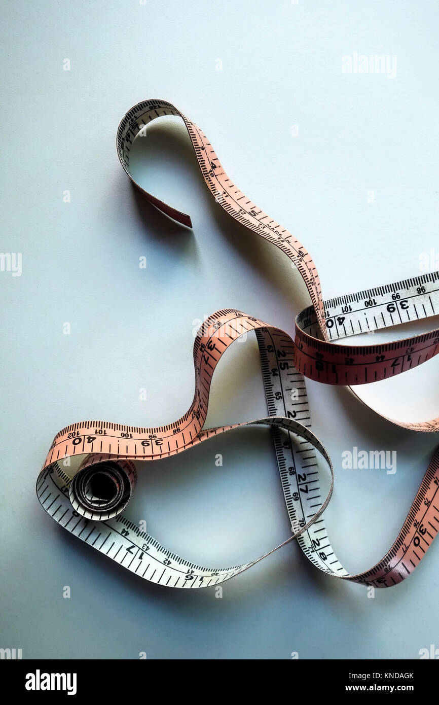 Measuring Tape on White background - Stock Image
