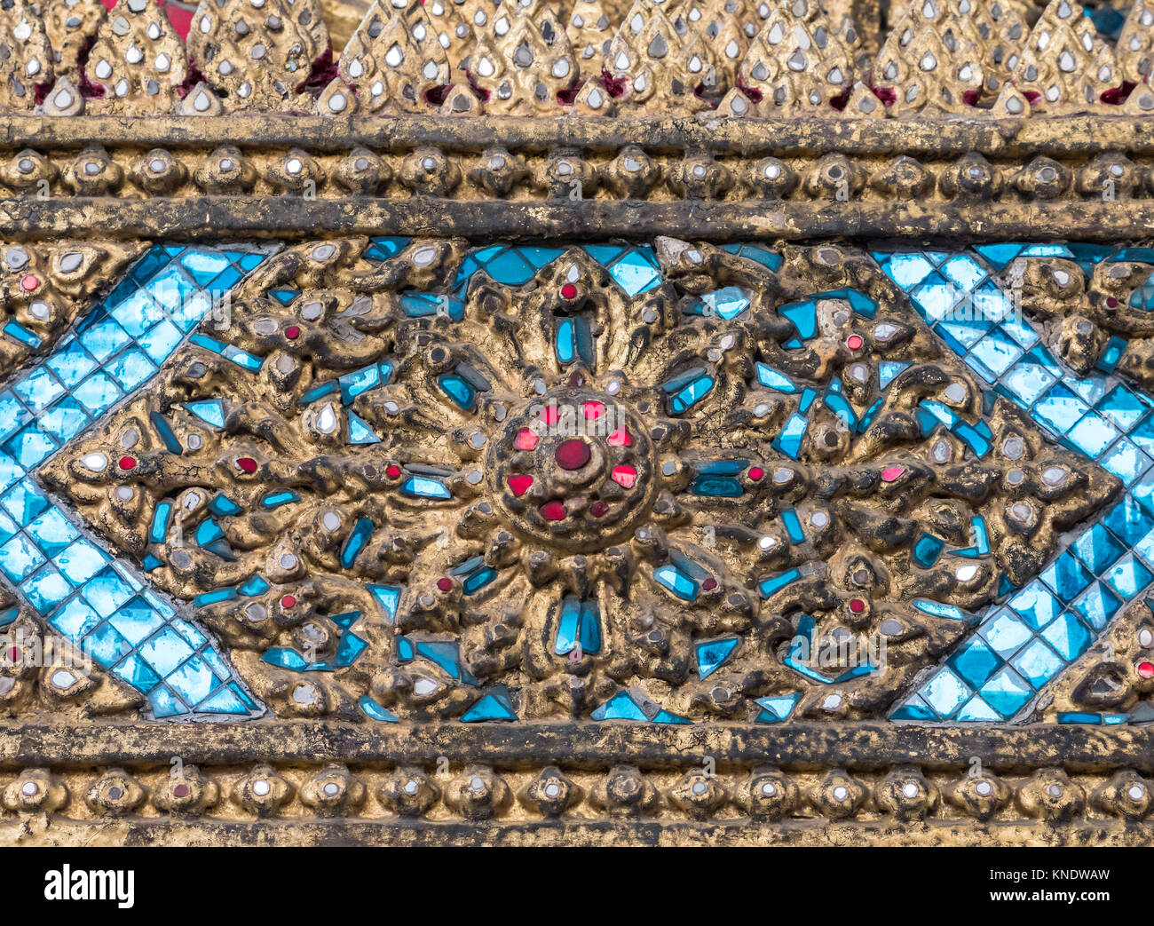 b5b662d0331 Ancient flower pattern in the traditional Thai style with blue mosaic on  the church wall of
