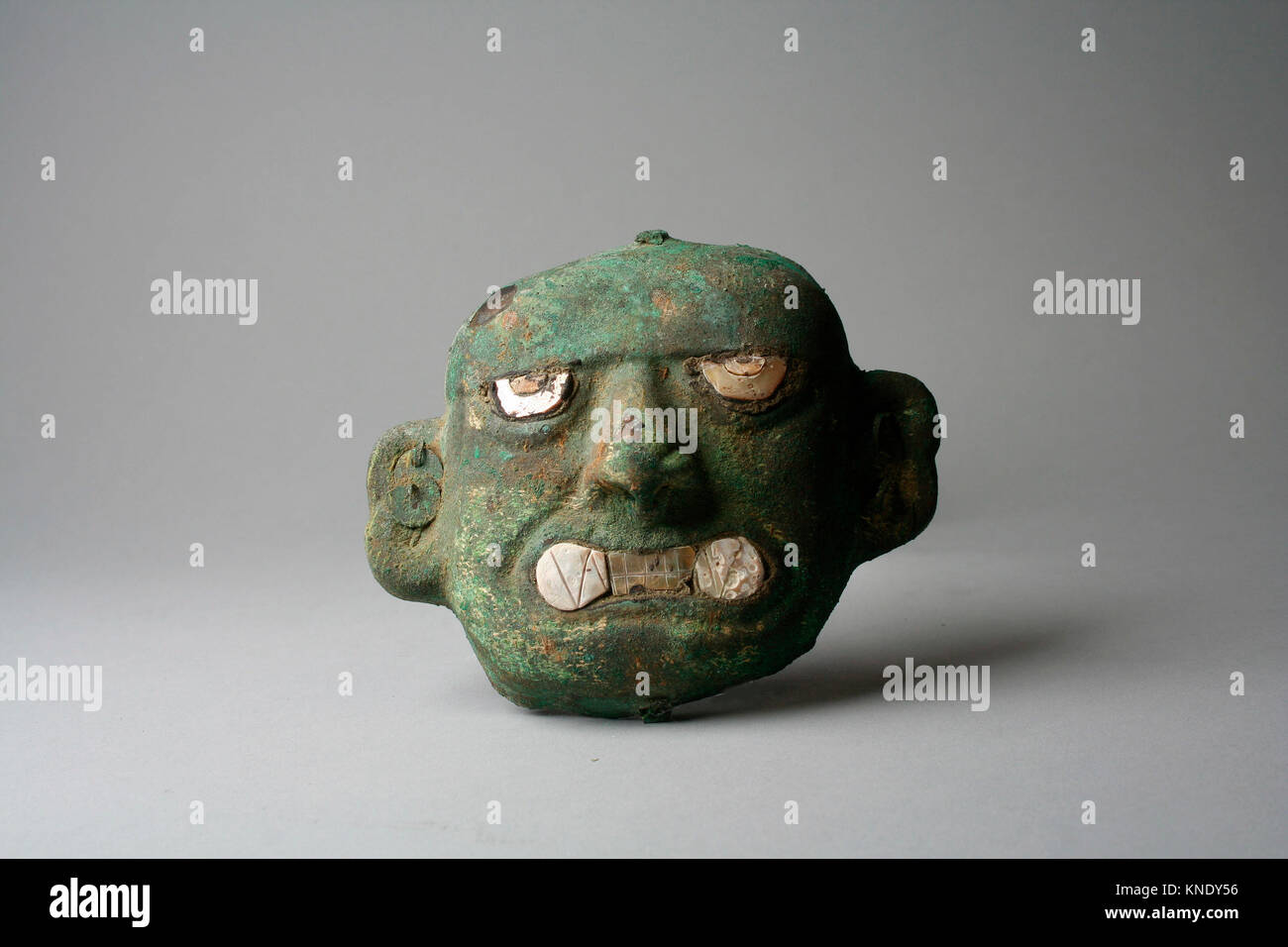 Face Mask Ornament. Date: 390-450; Geography: Peru; Culture: Moche (Loma Negra); Medium: Silvered copper, shell; - Stock Image