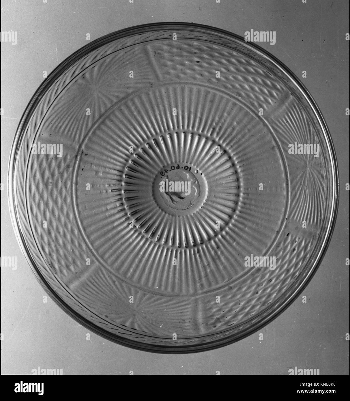 Bowl MET 110747 662 Bowl, 1820?40, Blown molded lead glass, H. 2 1/4 in. (5.7 cm); Diam. 10 in. (25.4 cm). The Metropolitan Stock Photo