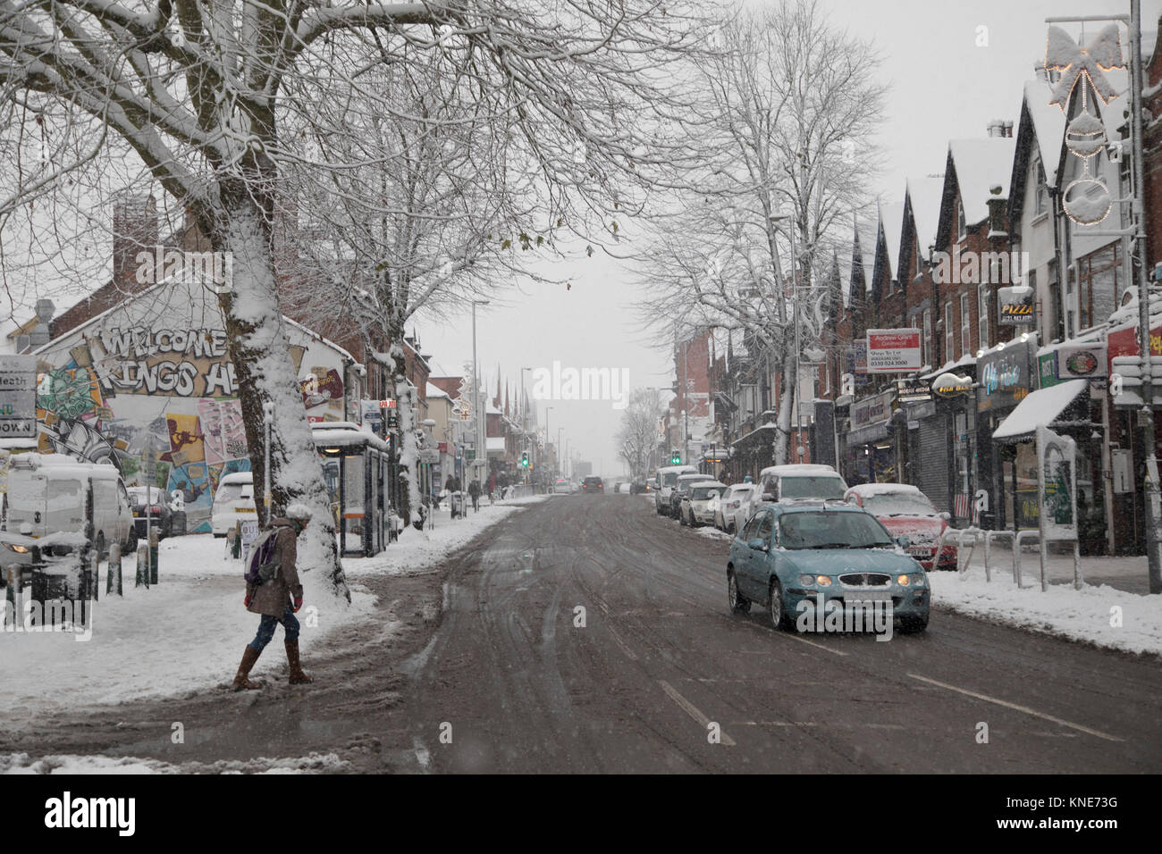 People out on Kings Heath High Street during heavy snow fall on Sunday 10th December 2017 in Birmingham, United Stock Photo