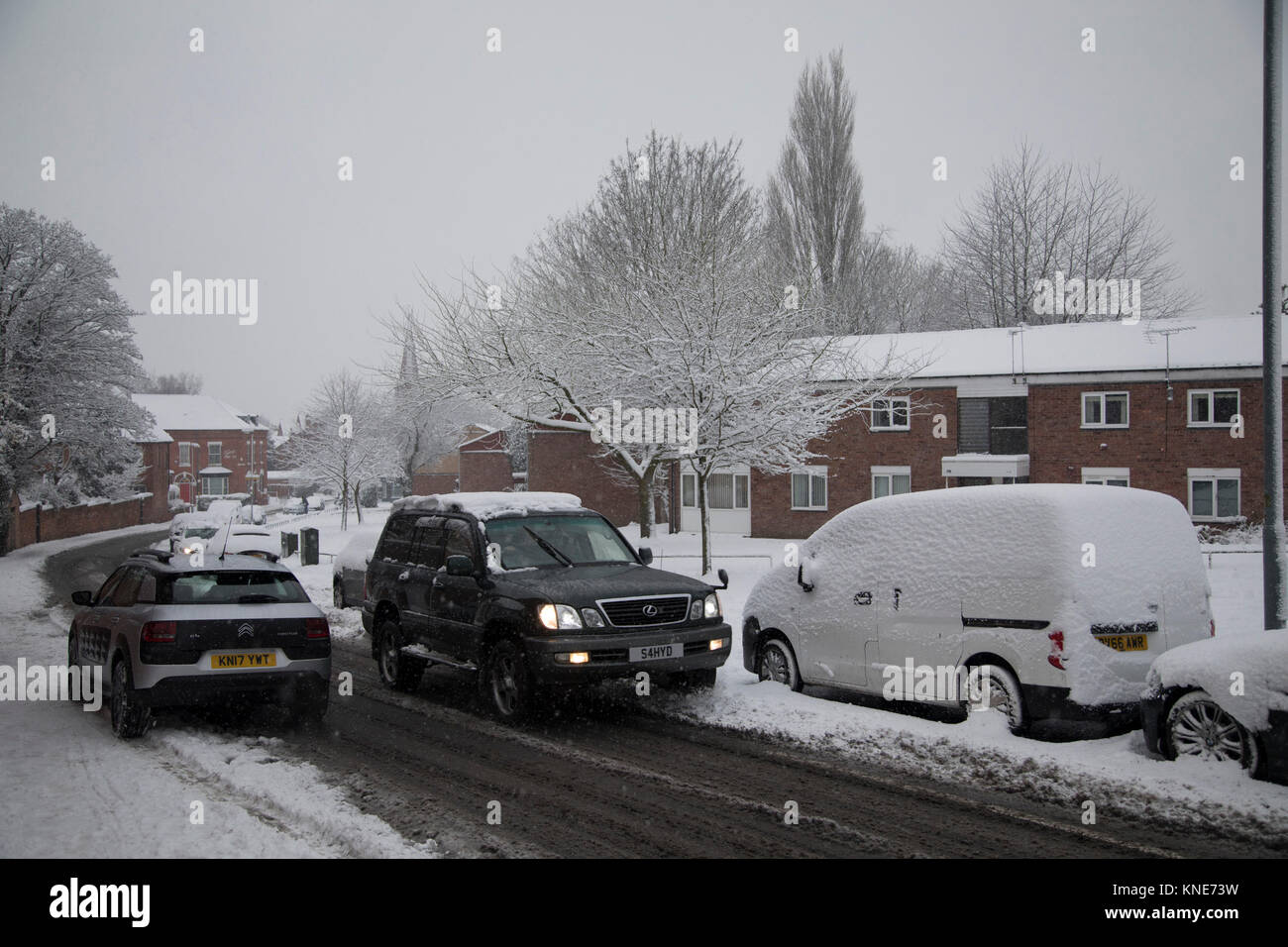 Street scene in Moseley during heavy snow fall on Sunday 10th December 2017 in Birmingham, United Kingdom. Deep - Stock Image