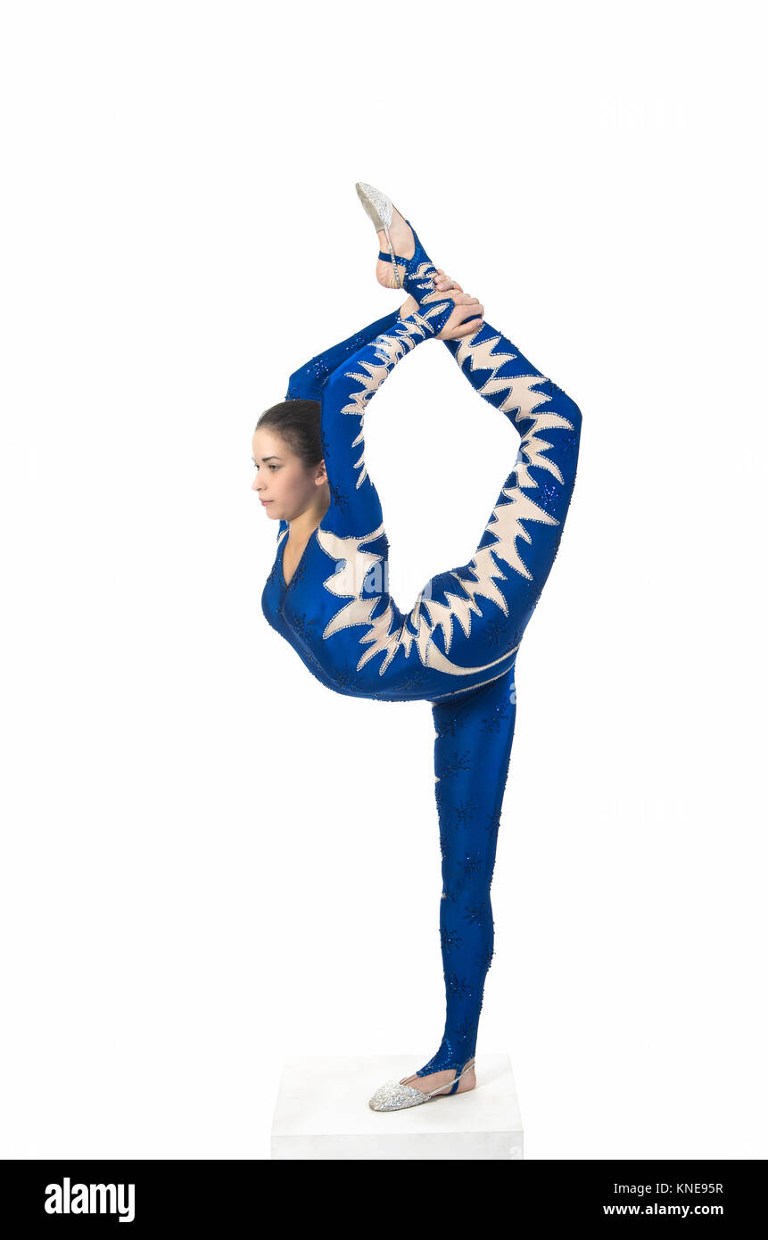 Acrobat does gymnastics, isolated image on a white background. A young circus artist in a blue suit , performs acrobatic - Stock Image