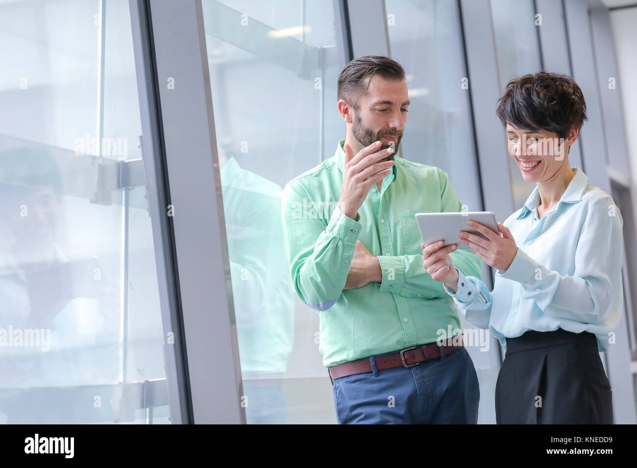 Executive couple with tablet - Stock Image